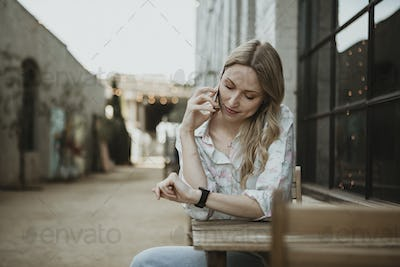 Woman waiting on a street