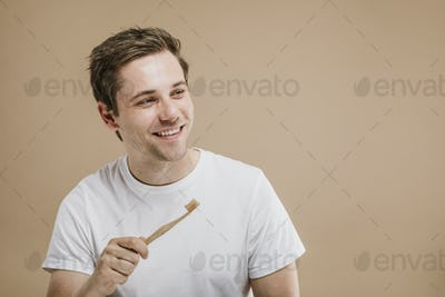 Man holding toothbrush