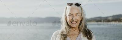 Happy senior woman by the sea