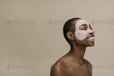 African woman wearing facial mask