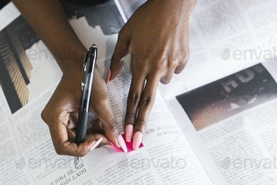 Woman working on a newspaper