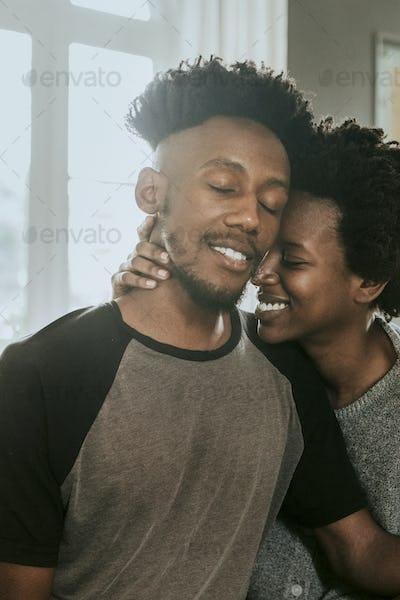 Black couple cuddling