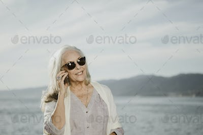 Woman on a call by the ocean