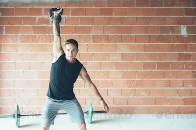 Sporty_young_man_doing_kettlebell_swing_exercise