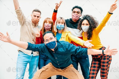 Multicultural people covered by protective face masks smiling at camera