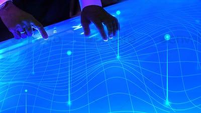 Man touching the futuristic blue screen