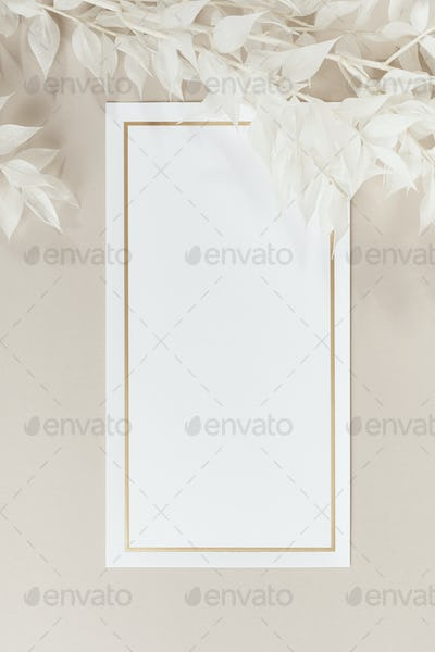 Blank white paper mockup and beige branches