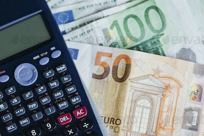Calculator and Euro banknotes on a table