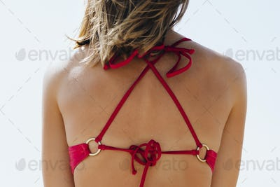 Rear view of a girl in a pink bikini