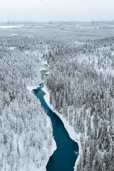 A river in winter at Oulanka National Park, Finland.