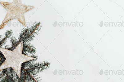 Wooden star ornament decorated pine tree background