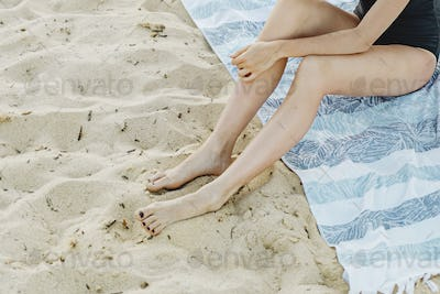 Woman sitting in the sand