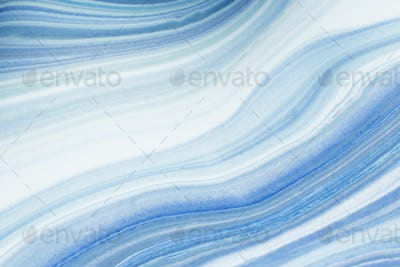 Blue marbled acrylic paint background