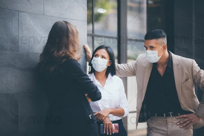 business people meeting with mask to prevent the spread of the virus covid19