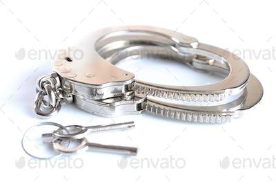 Close-up metal chrome handcuffs Handcuffs