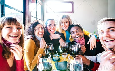 Friends taking selfie at winery bar drinking wine glass with open face mask