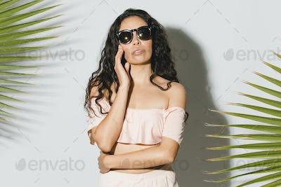 Woman in a swimsuit wearing sunglasses