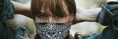 Woman covering her mouth with a bandana during coronavirus outbreak