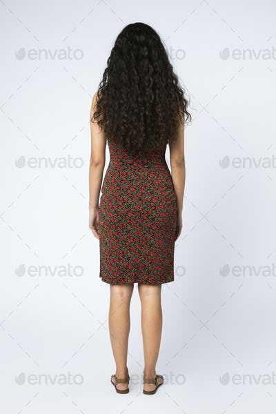 South American woman with long curly hair full body