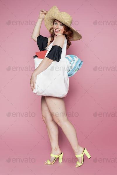 Beautiful woman using a tote bag