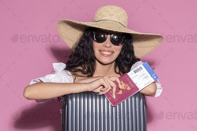 Happy woman ready for her summer trip