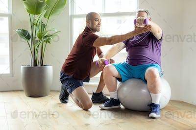 Injured mature man exercising