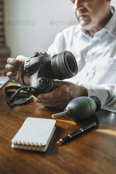 Old photographer with his camera
