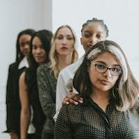 Confident businesswomen in a line