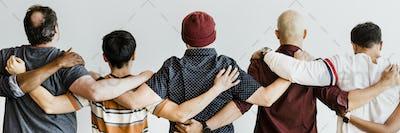 Team holding around each other