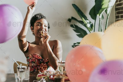 A young woman celebrating at a party