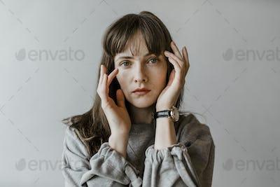 Brunette in a gray sweater