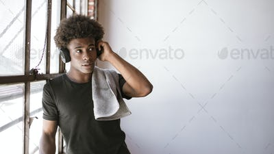 African American boy enjoying post workout music session