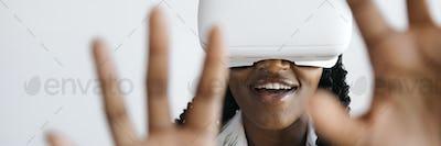 Black woman enjoying a VR headset