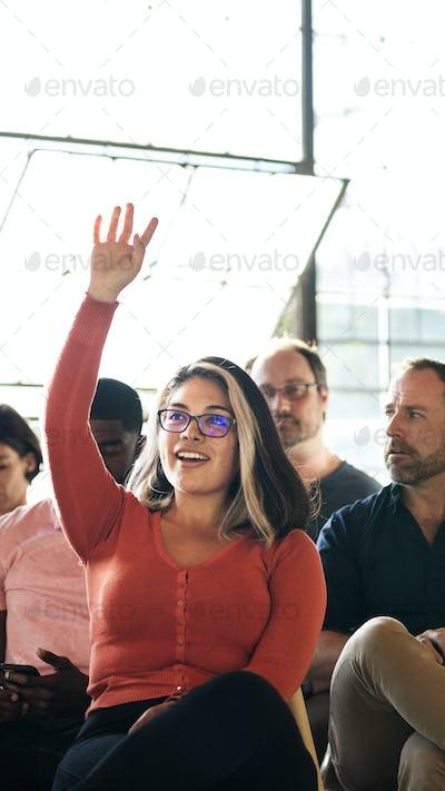 Cheerful woman speaking in a workshop
