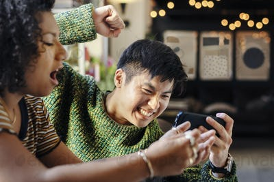 Couple playing online mobile game