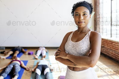 Trainer and her students in a yoga class