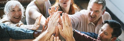 People joining hands in the air