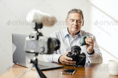 Photographer vlogging about cameras