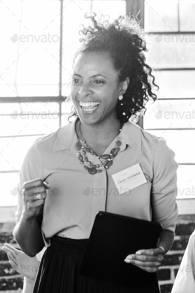 Positive businesswoman in black and white