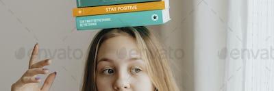 Cute teen girl with books