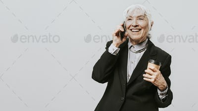Professional woman with a coffee in a black suit