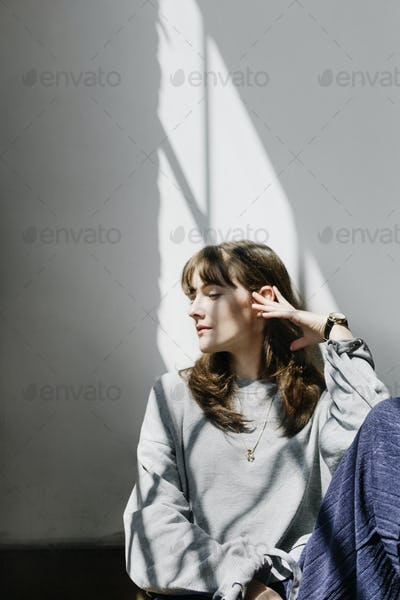 Model posing in a natural light studio