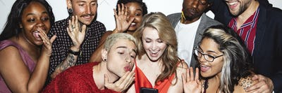 Diverse group of friends taking a selfie at a party