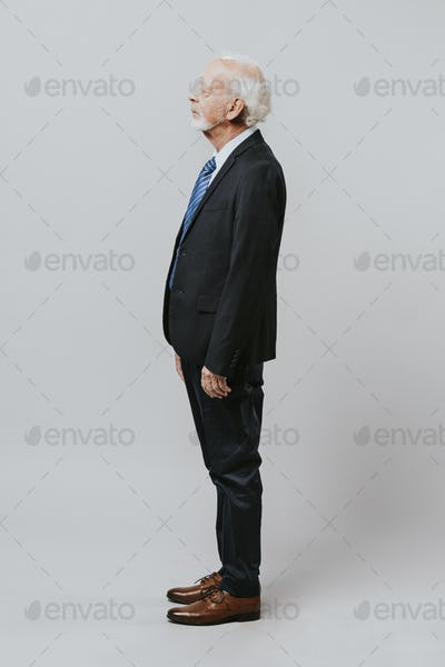 Businessman full body side portrait