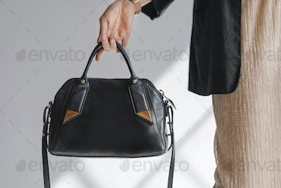 Black leather purse product shoot