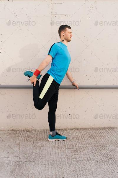 Caucasian man stretching city workout