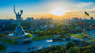 Aerial view to the Motherland statue in the Kiev while  summer sunset.