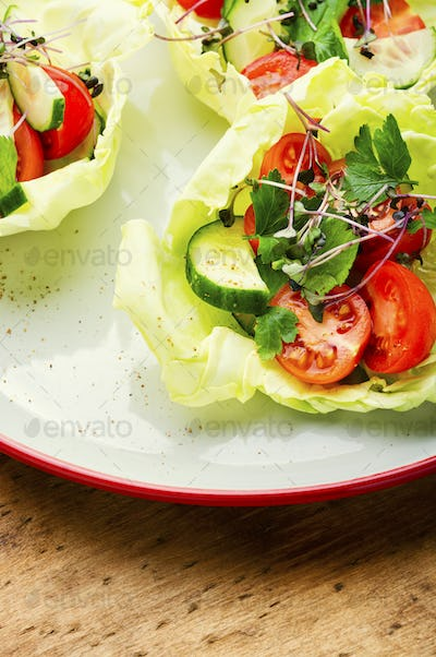 Plate of salad with vegetables and green
