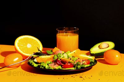 Healthy breakfast with salmon salad with avocado, sesame seeds, tomatoes mixed herbs