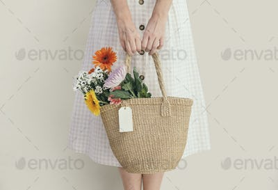 Girl carrying a bouquet in her bag